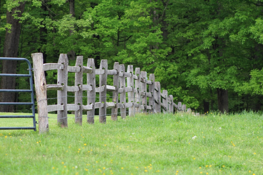 Fence with wooden posts and wooden horizontals